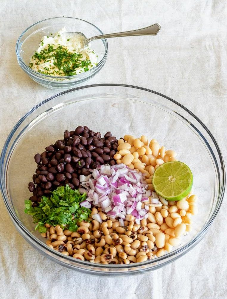 Ingredients for three bean salad in a bowl.