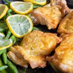 Lemon Pepper Chicken Thighs with Green beans and fresh lemon slices.